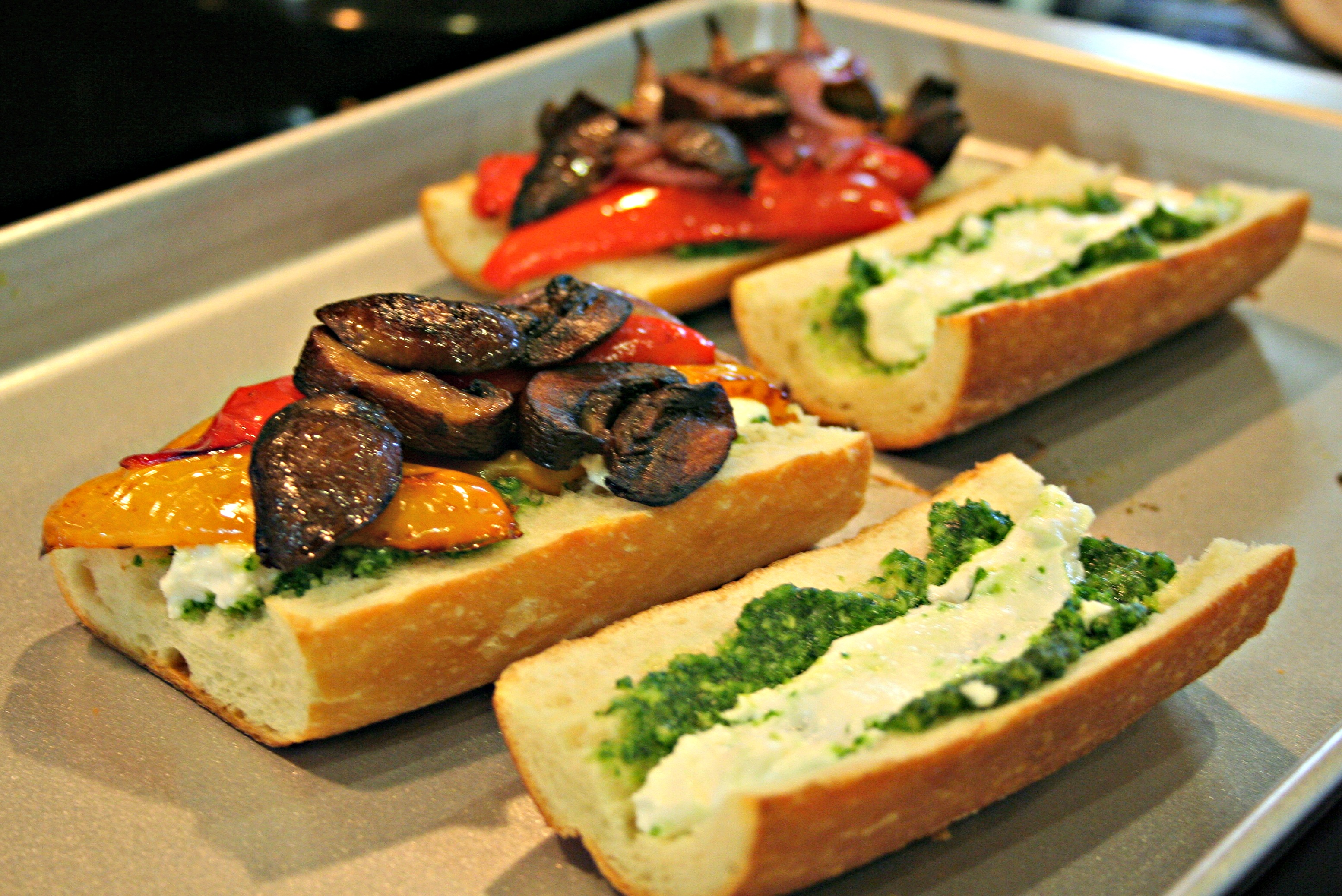 sandwich pesto and roasted vegetable eggplant while sitting a roasted ...